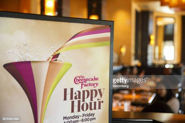 Signage is displayed in the bar area at a Cheesecake Factory Inc restaurant in the Canoga Park neighborhood of Los Angeles California US on Tuesday...