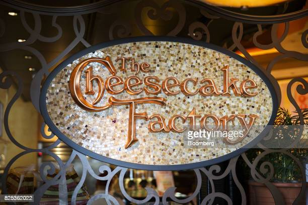 Signage is displayed inside of a Cheesecake Factory Inc restaurant in the Canoga Park neighborhood of Los Angeles California US on Tuesday Aug 1 2017...