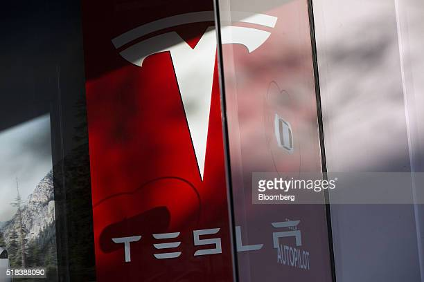Signage is displayed inside of the Tesla Motors Inc store on the Third Street Promenade in Santa Monica California US on Wednesday March 30 2016...