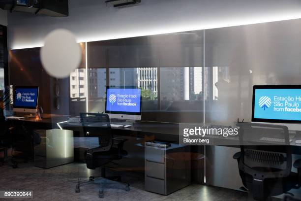 Signage is displayed on computer monitors in a classroom at the Facebook Inc Hack Station in Sao Paulo Brazil on Monday Dec 11 2017 The Facebook Hack...