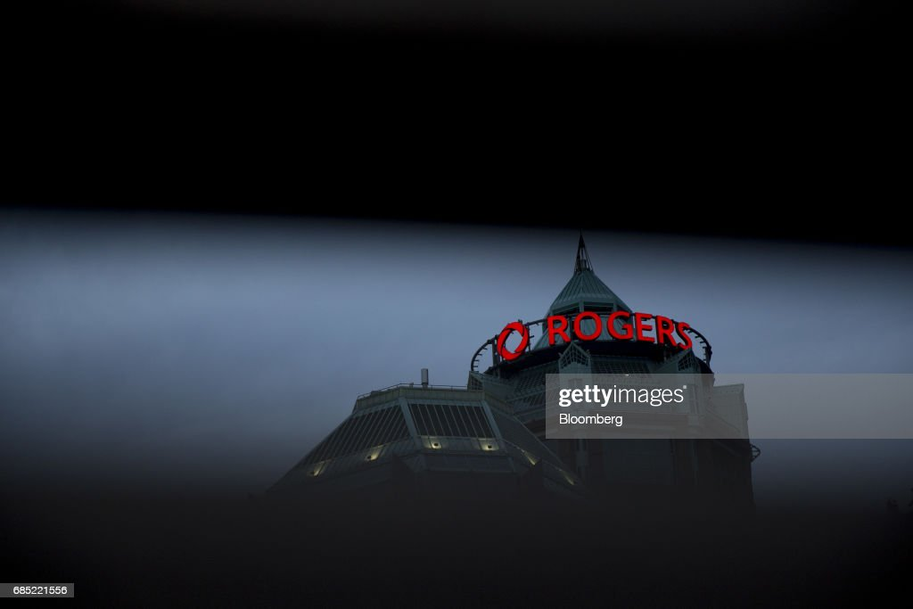Signage is displayed on the exterior of Rogers Communications Inc. headquarters in Toronto, Ontario, Canada, on Wednesday, May 17, 2017. Rogers Communications, Canada's largest wireless carrier, is leveraging organic growth in the country's wireless market to expand its subscriber base. Photographer: Brent Lewin/Bloomberg via Getty Images