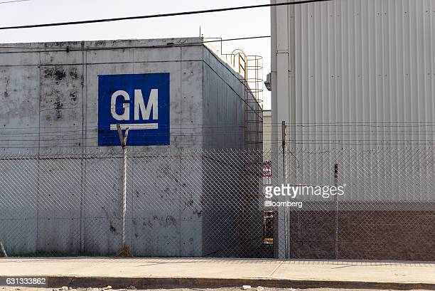 Signage is displayed on the exterior of the General Motors Co assembly plant in Toluca de Lerdo Mexico on Saturday Jan 7 2017 Presidentelect Donald...