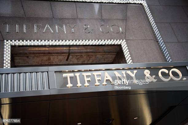 Signage is displayed on the exterior of the Tiffany Co flagship store on Fifth Avenue in New York US on Saturday Nov 26 2016 Tiffany Co is scheduled...