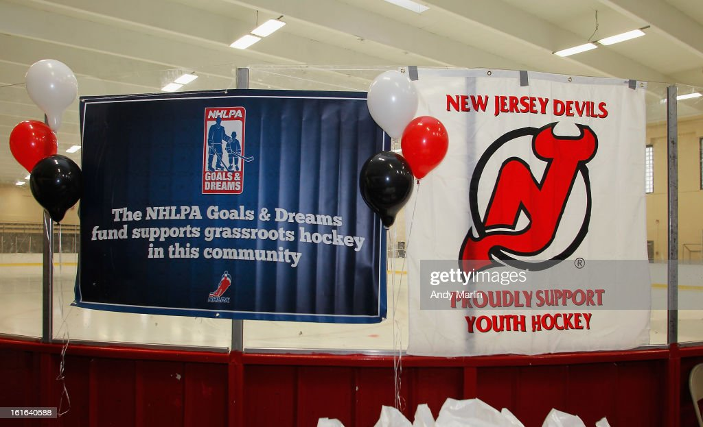 Signage is displayed on the glass during the Hockey in Newark instructional clinic on February 13, 2013 in Newark, New Jersey.