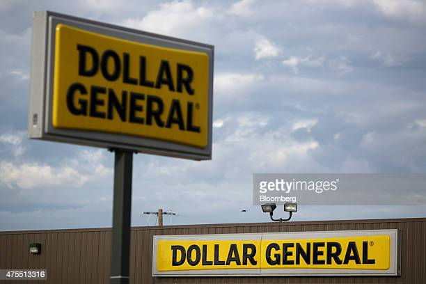 Signage is displayed outside a Dollar General Corp store in Bonnieville Kentucky US on Tuesday May 26 2015 Dollar General Corp is expected to report...