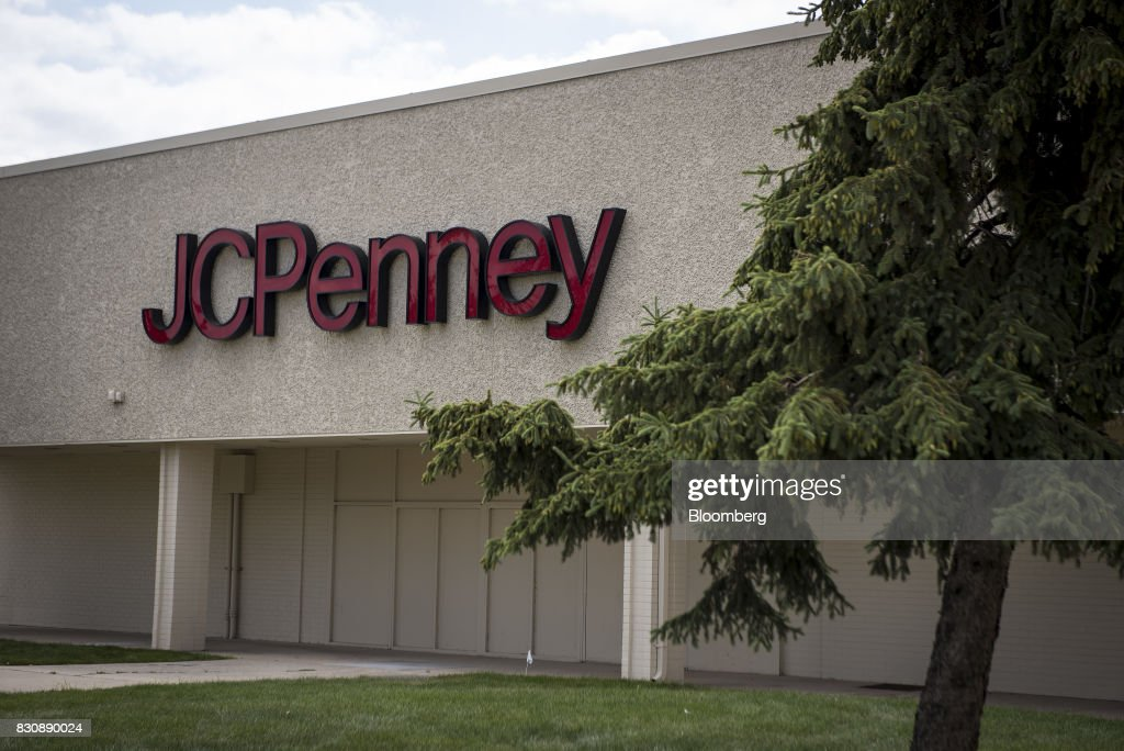 Signage is displayed outside a JC Penney Co. store in Chicago, Illinois, U.S., on Saturday, Aug. 12, 2017. On Friday morning, JC Penney posted a deeper loss than analysts expected -- hurt by clearance sales -- sending the shares on their worst decline in more than four years. Photographer: Christopher Dilts/Bloomberg via Getty Images