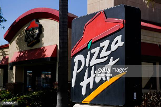 Signage is displayed outside a Pizza Hut restaurant a unit of Yum Brands Inc in Torrance California US on Monday Oct 7 2013 Yum Brands Inc is...