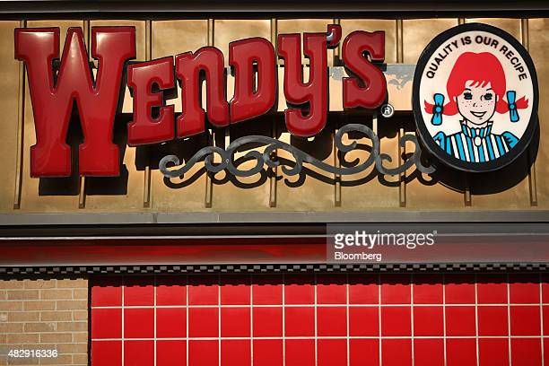 Signage is displayed outside a Wendy's Co restaurant in Springdale Arkansas US on Tuesday July 28 2015 Wendy's Co is scheduled to release quarterly...