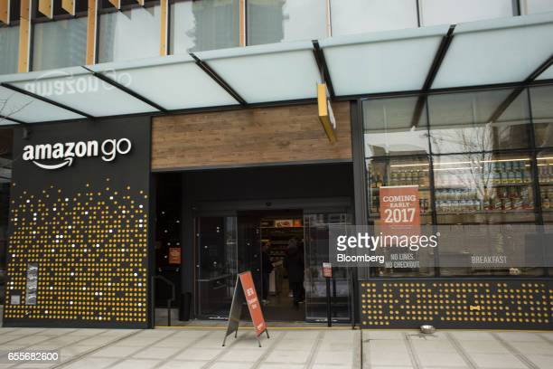Signage is displayed outside an Amazoncom Inc Go grocery store in Seattle Washington US on Wednesday March 8 2017 Amazon's goal is to become a Top 5...