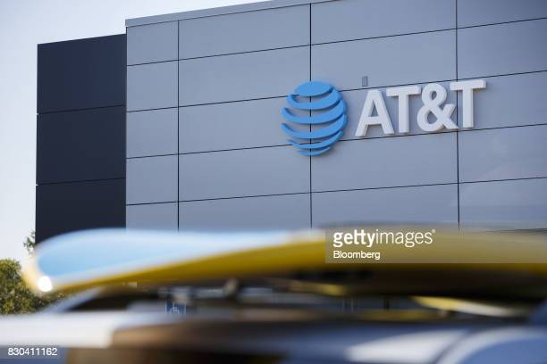 Signage is displayed outside of an ATT Inc store in Newport Beach California US on Thursday Aug 10 2017 ATT Inc shares surged the most in more than...