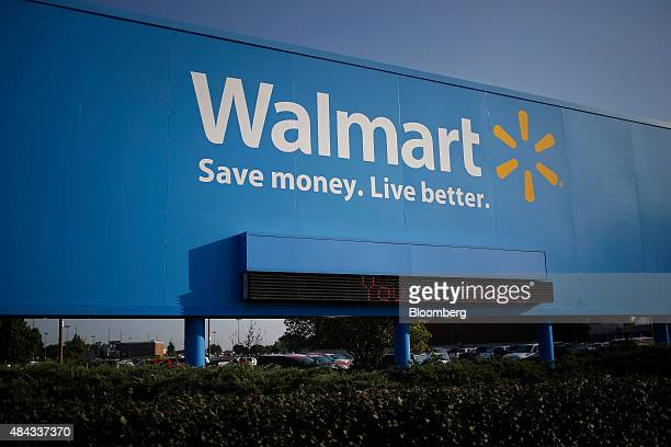 Signage is displayed outside of the WalMart Stores Inc headquarters building in Bentonville Arkansas US on Wednesday July 29 2015 WalMart Stores Inc...