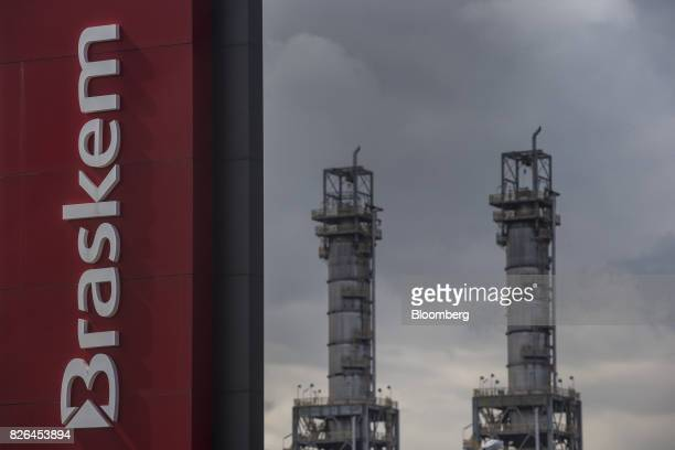 Signage is displayed outside the Braskem SA petrochemical plant in Duque de Caxias Brazil on Friday Aug 4 2017 Petroleo Brasileiro SA and Odebrecht...