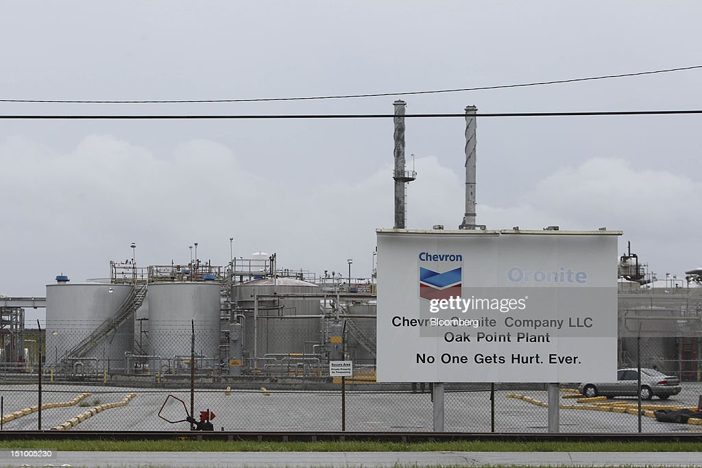 Signage is displayed outside the Chevron Corp. Oronite Oak Point Plant that was forced to close due to Hurricane Isaac in Belle Chasse, Louisiana, U.S., on Thursday, Aug. 30, 2012. Gasoline fell on speculation that South Louisiana refineries escaped major damage from Hurricane Isaac and downtime will be limited. Photographer: Derick E. Hingle/Bloomberg via Getty Images