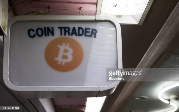 Signage is displayed outside the Coin Trader bitcoin retail store in Tokyo Japan on Wednesday Aug 30 2017 Stock of Bitcoin the bestknown digital...
