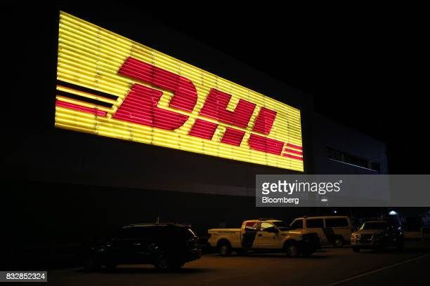 Signage is displayed outside the DHL Worldwide Express hub of Cincinnati/Northern Kentucky International Airport in Hebron Kentucky US on Wednesday...