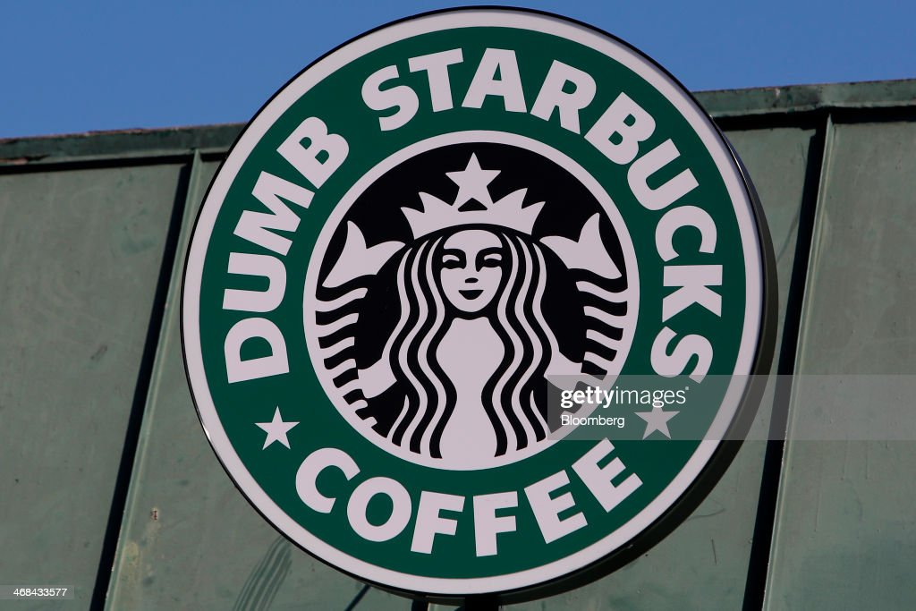 Signage is displayed outside the Dumb Starbucks Coffee store, a parody of the Starbucks Corp. coffee chain, in Los Angeles, California, U.S., on Monday, Feb. 10, 2014. Dumb Starbucks, which opened this past weekend, offered Dumb Vanilla Blonde Roast, Dumb Chai Tea Latte, and Dumb Caramel Macchiato, all available in sizes Dumb Venti, Dumb Grande, and Dumb Tall. Photographer: Patrick T. Fallon/Bloomberg via Getty Images