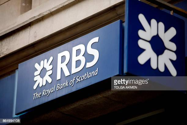 Signage is seen at the front of a branch of the Royal Bank of Scotland in central London on October 22 2017 / AFP PHOTO / AFP PHOTO AND Tolga Akmen /...