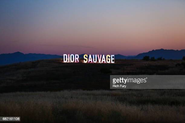 Signage is seen during the Christian Dior Cruise 2018 Runway Show at the Upper Las Virgenes Canyon Open Space Preserve on May 11 2017 in Santa Monica...