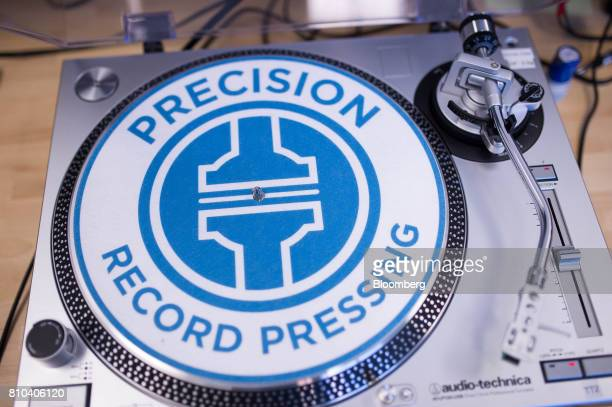 Signage is seen on a record player in the audio check station at the Precision Record Pressing facility in Burlington Ontario Canada on Friday June...