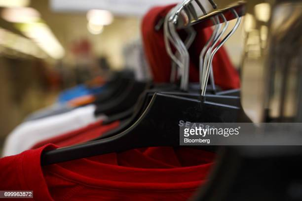 Signage is seen on hangars displaying clothing for sale at a Sears Canada Inc store inside a mall in Toronto Ontario Canada on Thursday June 22 2017...