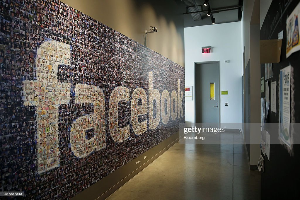 Signage made up of individual faces is displayed inside the Facebook Inc. Prineville Data Center in Prineville, Oregon, U.S., on Monday, April 28, 2014. The Facebook Prineville Data Center features leading energy-efficient technology, including features such as rainwater reclamation, a solar energy installation for providing electricity to the office areas and reuse of heat created by the servers to heat office space. Photographer: Meg Roussos/Bloomberg via Getty Images