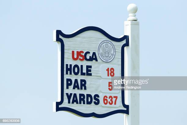 Signage marks the 18th tee during a practice round prior to the 2017 US Open at Erin Hills on June 12 2017 in Hartford Wisconsin