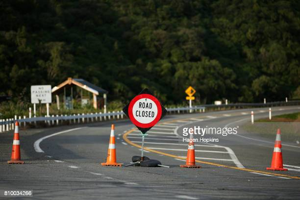 Signage marks the beginning of a road closure at Manawatu Gorge on July 7 2017 in Palmerston North New Zealand The highway was closed on April 24...