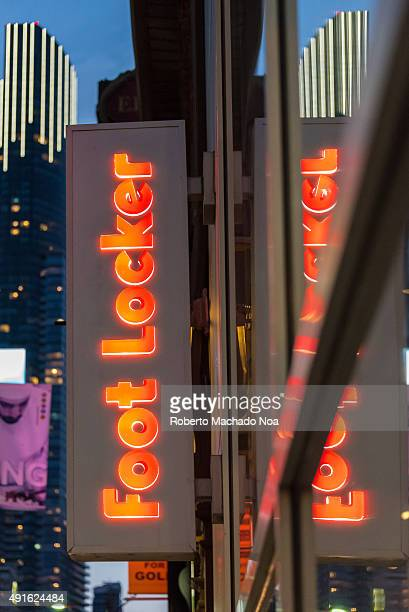 DOWNTOWN TORONTO ONTARIO CANADA Signage of Foot Locker in vertical form with its reflection falling on the glassy wall Foot Locker Retail Inc is an...