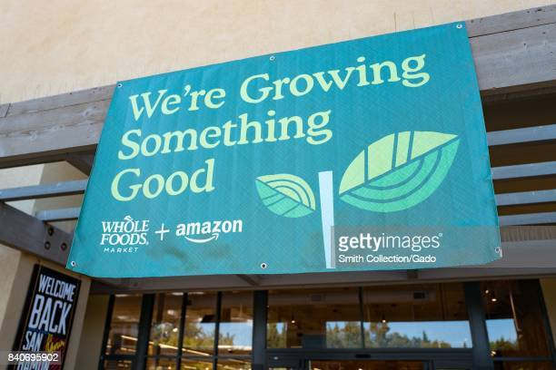 Signage on the Whole Foods Market store in San Ramon California reading 'We're growing something good' announcing the acquisition of Whole Foods...