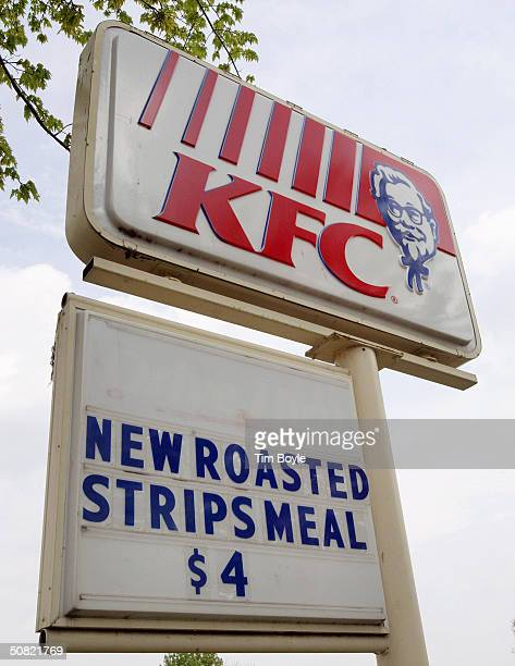 Signage promoting a new roasted menu item is visible at a KFC restaurant May 10 2004 in Rolling Meadows Illinois KFC Corporation today unveiled its...