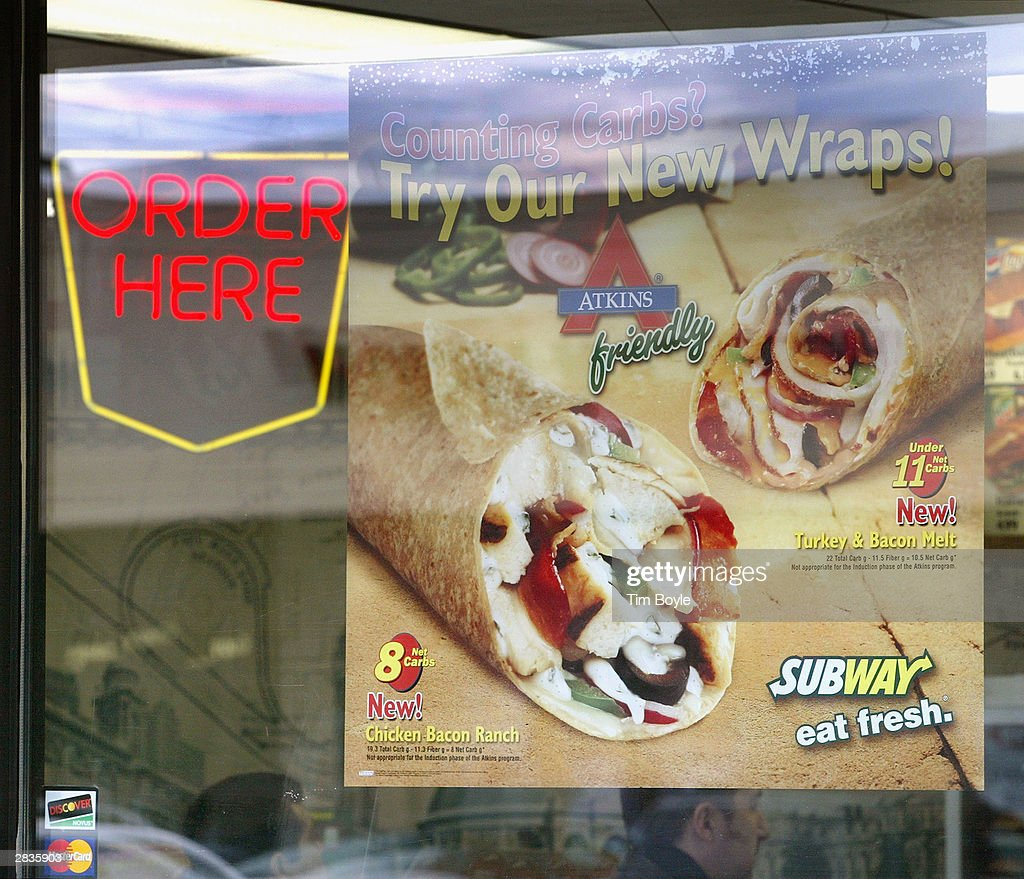Signage promoting Subway's new wraps is seen December 29, 2003 in Chicago. Subway restaurants today started to offer two Atkins Nutritionals, Inc.-endorsed low-carbohydrate wraps. The Turkey and Bacon Melt Wrap with Monterey cheddar cheese and the Chicken Bacon Ranch Wrap with Swiss cheese. Both Atkins-Friendly Wraps are available in the U.S. and Canada and have 11 grams Net Carbs or less. The wrap itself, which is made with wheat gluten, cornstarch, oat, sesame flour and soy protein, has only 5 grams Net Carbs. Subway Restaurants is the first quick serve restaurant to partner with Atkins Nutritionals Inc.