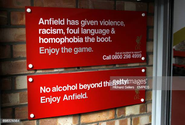 Signage reading 'Anfield has given violence racism foul language and homophobia the boot' and 'No alcohol beyond this point'