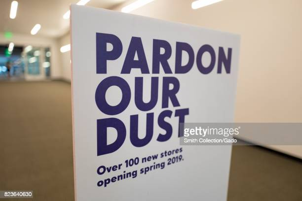 Signage reading 'Pardon Our Dust' and announcing the opening of 100 new stores in 2019 during a renovation at the Westfield Valley Fair shopping mall...