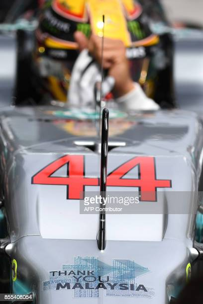 A signage reading ' Thank you Malaysia ' is seen on Mercedes's British driver Lewis Hamilton's car during the second practice session of the Formula...