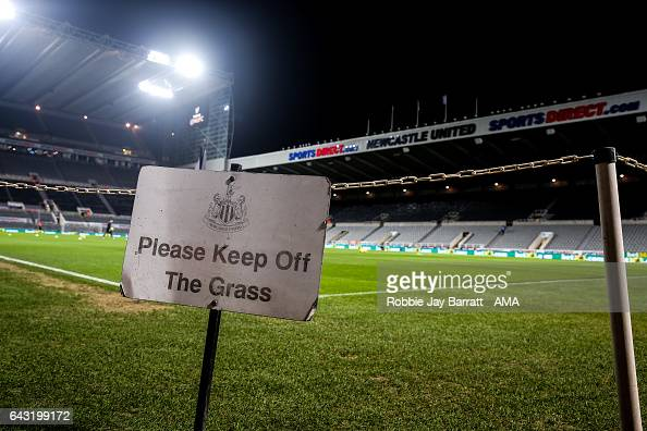 Signage reads Please Keep Off The Grass during the Sky Bet Championship match between Newcastle United and Aston Villa at St James' Park on February...
