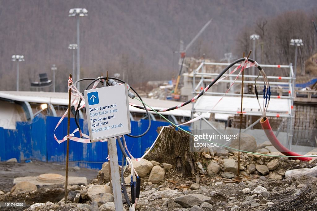 Signage sits among ongoing construction work during the FIBT Bob and Skeleton World Cup 2012/13 at the Sanki Sliding Centre, some 50 km from Russia's Black Sea resort of Sochi, on February 15, 2013. Takahashi ended up coming twentieth on the day and fifteenth in the final standings, with Latvia's Martins Dukurs winning the FIBT Skeleton World Cup 2012/13. With a year to go until the Sochi 2014 Winter Games, construction work continues as tests events and World Championship competitions are underway. AFP PHOTO / LEON NEAL