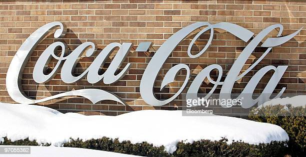 Signage sits on display outside the CocaCola Enterprises Inc bottling facility in Niles Illinois US on Thursday Feb 25 2010 CocaCola Co the world's...