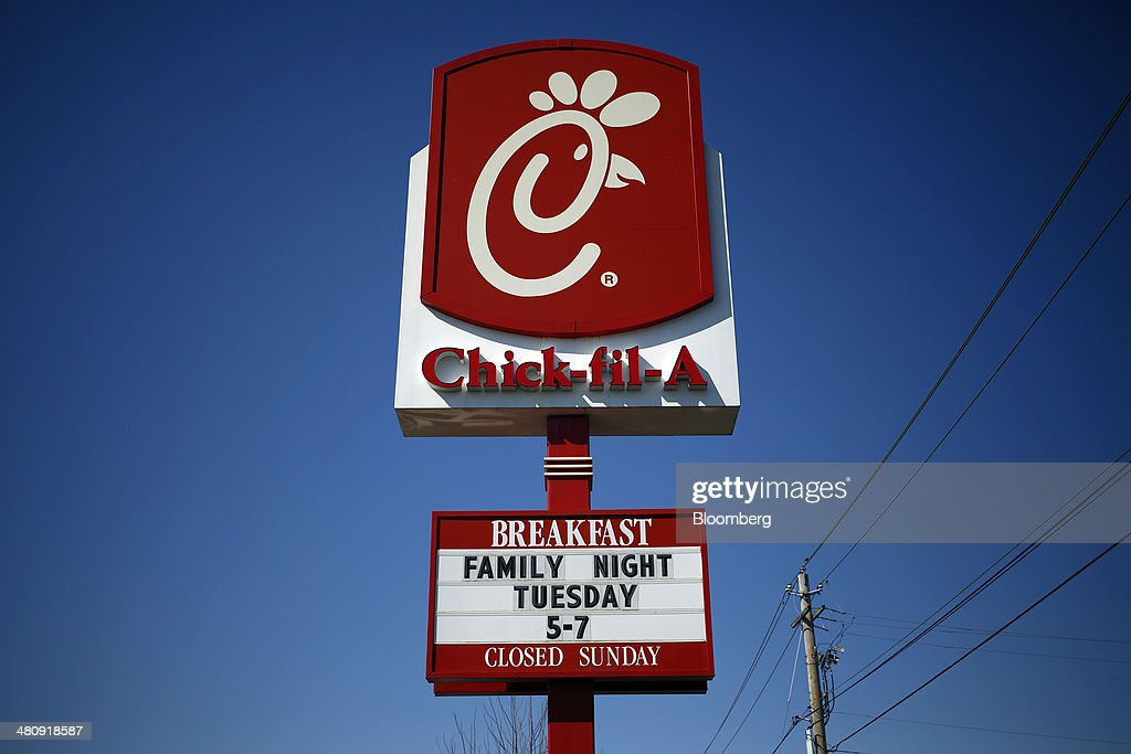 Signage stands outside a Chick-fil-A Inc. restaurant in Bowling Green, Kentucky, U.S., on Tuesday, Mar. 25, 2014. The U.S. economy grew more rapidly in the fourth quarter than previously estimated as consumer spending climbed by the most in three years, showing the expansion had momentum heading into this years harsh winter. Photographer: Luke Sharrett/Bloomberg via Getty Images