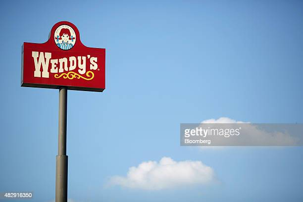 Signage stands outside a Wendy's Co restaurant in Springdale Arkansas US on Tuesday July 28 2015 Wendy's Co is scheduled to release quarterly...