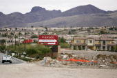 Signage stands outside of the 2000 acre Inspirada residential and commercial development in Henderson Nevada US on Thursday Dec 16 2010 JPMorgan...