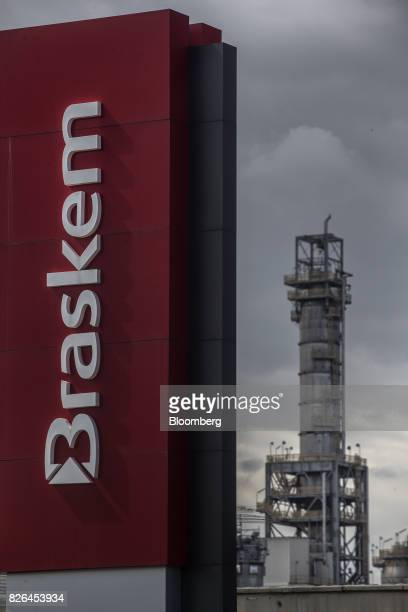 Signage stands outside the Braskem SA petrochemical plant in Duque de Caxias Brazil on Friday Aug 4 2017 Petroleo Brasileiro SA and Odebrecht SA...