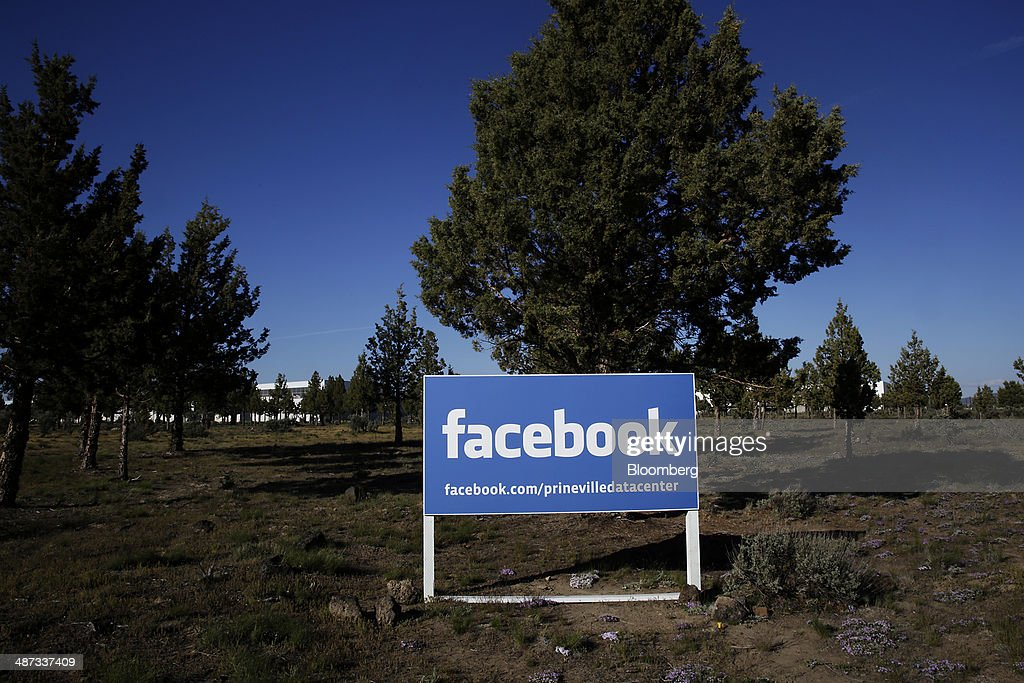 Signage stands outside the Facebook Inc. Prineville Data Center in Prineville, Oregon, U.S., on Monday, April 28, 2014. The Facebook Prineville Data Center features leading energy-efficient technology, including features such as rainwater reclamation, a solar energy installation for providing electricity to the office areas and reuse of heat created by the servers to heat office space. Photographer: Meg Roussos/Bloomberg via Getty Images