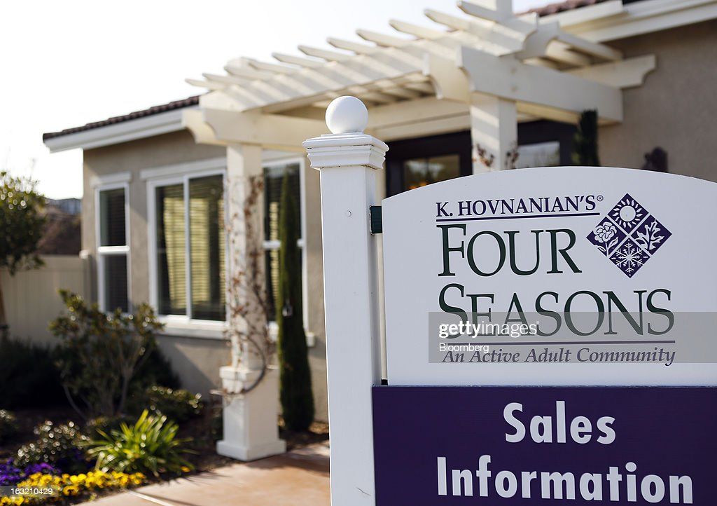Signage stands outside the sales office at the Hovnanian Enterprises Inc.'s Four Seasons housing development in Beaumont, California, U.S., on Monday, March 4, 2013. Hovnanian Enterprises Inc., the best-performing U.S. homebuilder stock in the past 12 months, reported a narrower loss for its fiscal first quarter as sales and orders increased amid a housing rebound. Photographer: Patrick T. Fallon/Bloomberg via Getty Images
