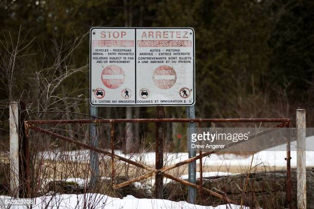 Signage warns visitors that entry across the USCanada border at this point is prohibited February 22 2017 in Hemmingford Quebec In the past month...