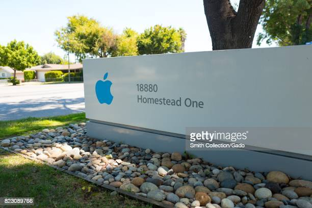 Signage with Apple Inc logo for the Homestead One office near the Apple Park known colloquially as 'The Spaceship' the new headquarters of Apple Inc...
