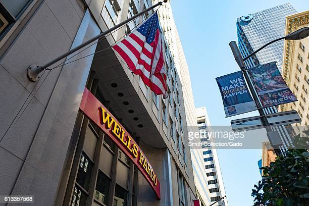 Signage with logo American Flag and unrelated banner reading 'We Make Success Happen' at headquarters of Wells Fargo Capital Finance the commercial...