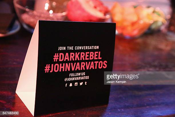 Signage with social hedia hashtags on the bar during the John Varvatos Spring/Summer 2017 Fashion Show after party celebrating the launch of Dark...