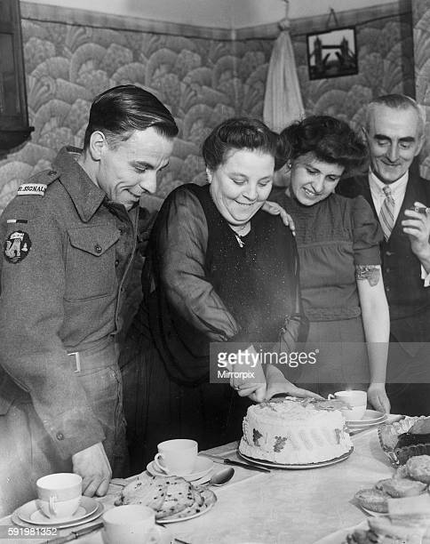 Signalman in the Royal Navy Andrew Cambpell about to eat a cake made for him by his mother for his 21st birthday during the Second World War May 1945