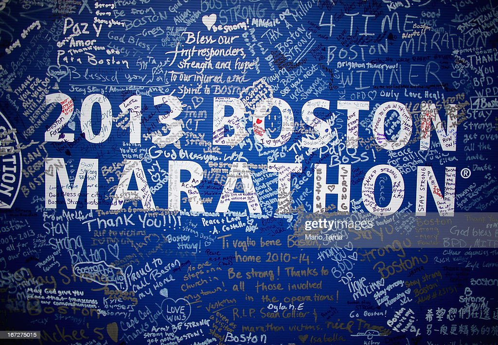 Signatures adorn a Boston Marathon poster near the site of the Boston Marathon bombings on April 23, 2013 in Boston, Massachusetts. Business owners and residents of the closed section were allowed to return to their properties today while under escort of city staff.