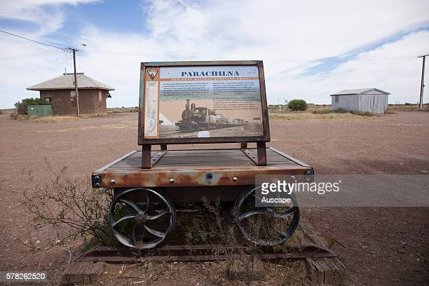 Signboard for the Old Ghan Railway Heritage Trail with the derelict railway station in the background The line from Port Augusta to Alice Springs was...
